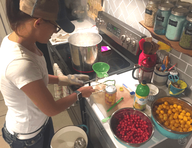September 2019: Woman canning tomatoes